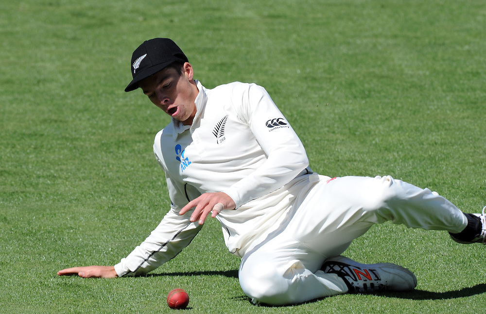 New Zealand's Mitchell Santner fields the ball on the boundary against Sri Lanka on day two of the second International Cricket Test, Seddon Park, Hamilton, New Zealand, Saturday, December 19, 2015. Credit:SNPA / Ross Setford