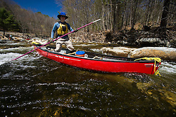 Poling a canoe on the Ashuelot River in Surry, NH.  A tributary of the Connecticut River.
