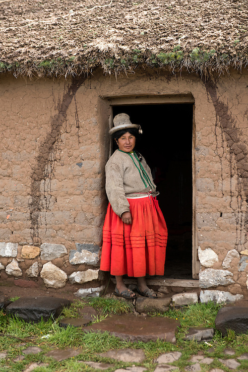 South America, Peru,Sillustani, native woman in front of her house