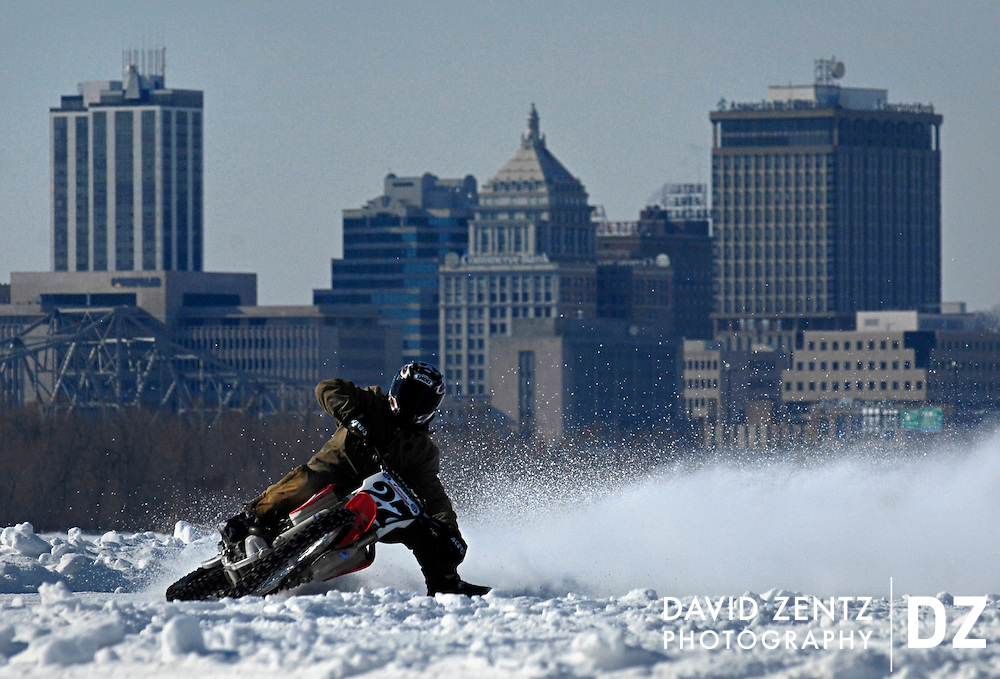 Motocross racer Rob Pearson, 21, slides in front of the Peoria skyline on a track atop a frozen Illinois River. Racers took advantage of unusually cold temperatures that froze the river for two weeks for the first time in years.