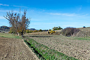 bulldozer flatting hilly agricultural land in France Languedoc Aude
