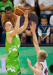 Klemen Prepelic of Slovenia vs Arturs Bremers of Latvia during basketball match between National teams of Latvia and Slovenia in Qualifying Round of U20 Men European Championship Slovenia 2012, on July 16, 2012 in Domzale, Slovenia. (Photo by Vid Ponikvar / Sportida.com)