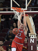 Western Kentucky Hilltoppers forward Justin Johnson (23) d unks the ball against the Southern California Trojans during an NCAA college basketball game in the second round of the NIT tournament in Los Angeles, Monday, Mar 19, 2018. WKU defeated USC 79-75.