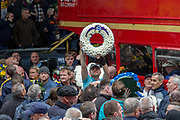Gavin Geddes holds a Brighton & Hove Albion Football club wreath during the Football Lads Alliance march between Park Lane and Westminster Bridge, London on 7 October 2017. Photo by Phil Duncan.