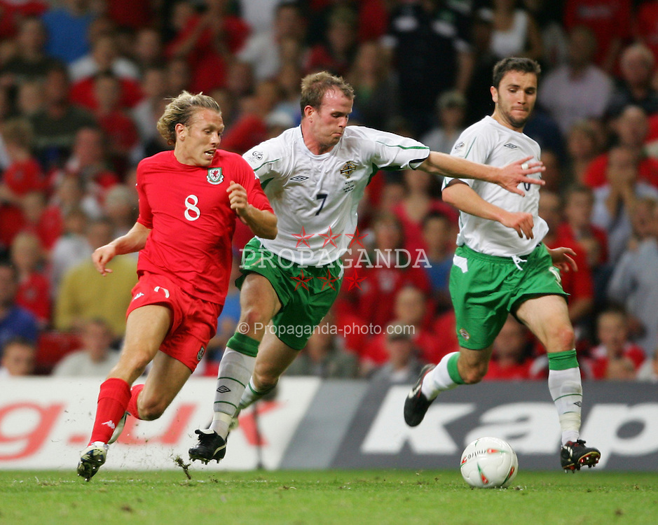 CARDIFF, WALES - Wednesday, September 8, 2004: Wales' Craig Bellamy in action against Northern Ireland's Mark Clyde during the Group Six World Cup Qualifier at the Millennium Stadium. (Pic by David Rawcliffe/Propaganda)