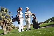 Senior Golfer with Granddaughter