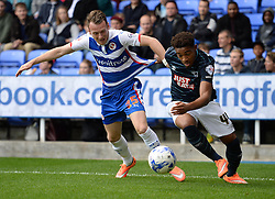 Derby County's Jordan Ibe battles for the ball with Reading's Jake Taylor - Photo mandatory by-line: Alex James/JMP - Mobile: 07966 386802 - 18/10/2014 - SPORT - Football - Reading - Madejski Stadium - Reading v Derby County - Sky Bet Championship