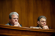 "Senators TOM COBURN (R-OK) and  AL FRANKEN (D-MN) listen to testimony during a Senate Privacy, Technology and the Law Subcommittee hearing on ""Protecting Mobile Privacy"" on Capitol Hill on Monday."