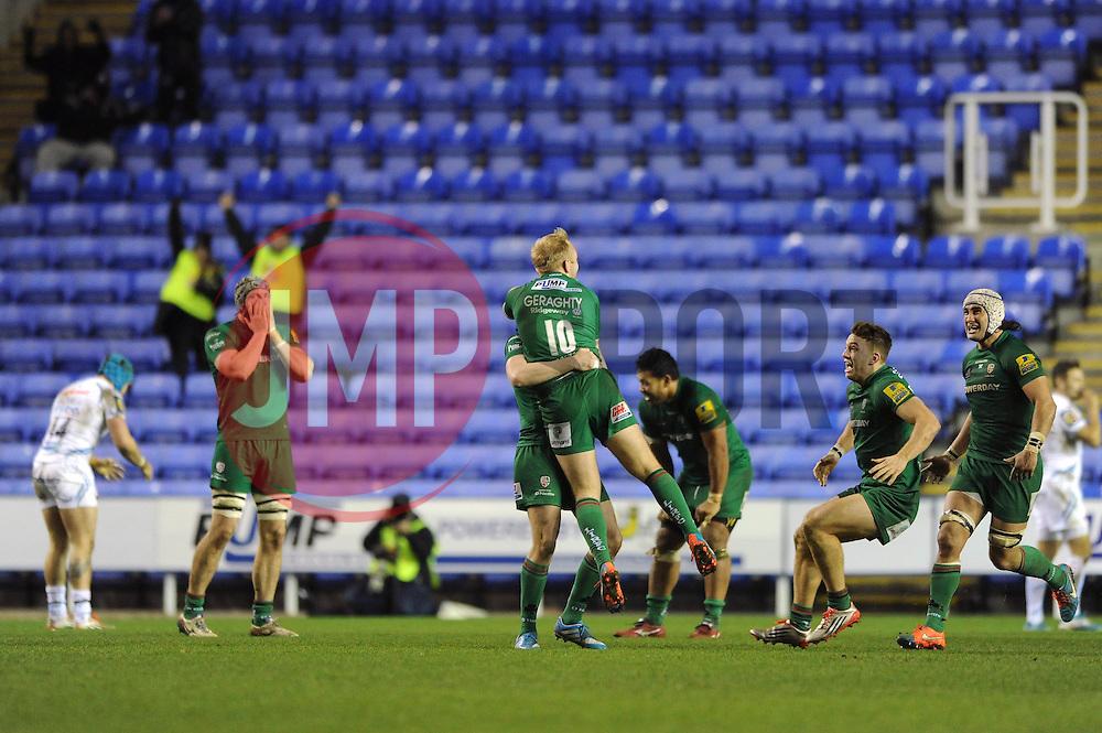 London Irish fly half, Shane Geraghty celebrates with team mates after scoring a last minute drop goal to make it 28 26 - Photo mandatory by-line: Dougie Allward/JMP - Mobile: 07966 386802 - 11/01/2015 - SPORT - RUGBY - Reading - Madejski Stadium - London Irish v Exeter Chiefs - Aviva Premiership