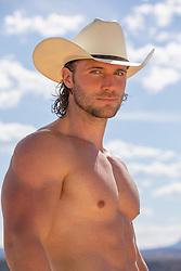 muscular shirtless cowboy outdoors