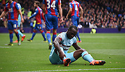 Victor Moses holds his ankle in tough return to Selhurst during the Barclays Premier League match between Crystal Palace and West Ham United at Selhurst Park, London, England on 17 October 2015. Photo by Michael Hulf.