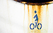 a rust stain seems to drench a bicycle stencil that marks a bicycle storage area aboard a Washington State Ferry, Washington, USA