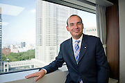 Michael C Woodford, president and COO of Olympus Corp., poses for a photo after an interview at the company's headquarters in Tokyo, Japan on 29 Aug. 2011.