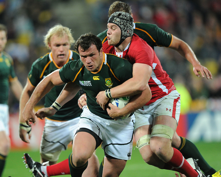 South Africa's Bismarck du Plessis held by Wales Danny Lydiate in the Rugby World Cup pool match at Wellington Stadium, Wellington, New Zealand, Sunday, September 11, 2011. Credit:SNPA / Ross Setford