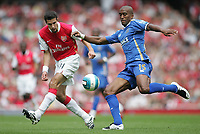 Photo: Lee Earle.<br /> Arsenal v Portsmouth. The FA Barclays Premiership. 02/09/2007.Arsenal's Robin Van Persie (L) battles with Sylvain Distin.