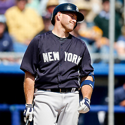 Mar 14, 2013; Dunedin, FL, USA; New York Yankees third baseman Kevin Youkilis (36) reacts after striking out during the top of the third inning of a spring training game against the Toronto Blue Jays at Florida Auto Exchange Park. Mandatory Credit: Derick E. Hingle-USA TODAY Sports