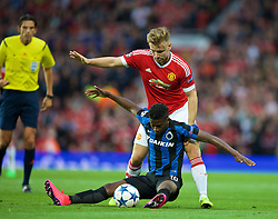 MANCHESTER, ENGLAND - Tuesday, August 18, 2015: Manchester United's Luke Shaw in action against Club Brugge's Abdoulay Diaby during the UEFA Champions League Play-Off Round 1st Leg match at Old Trafford. (Pic by David Rawcliffe/Propaganda)