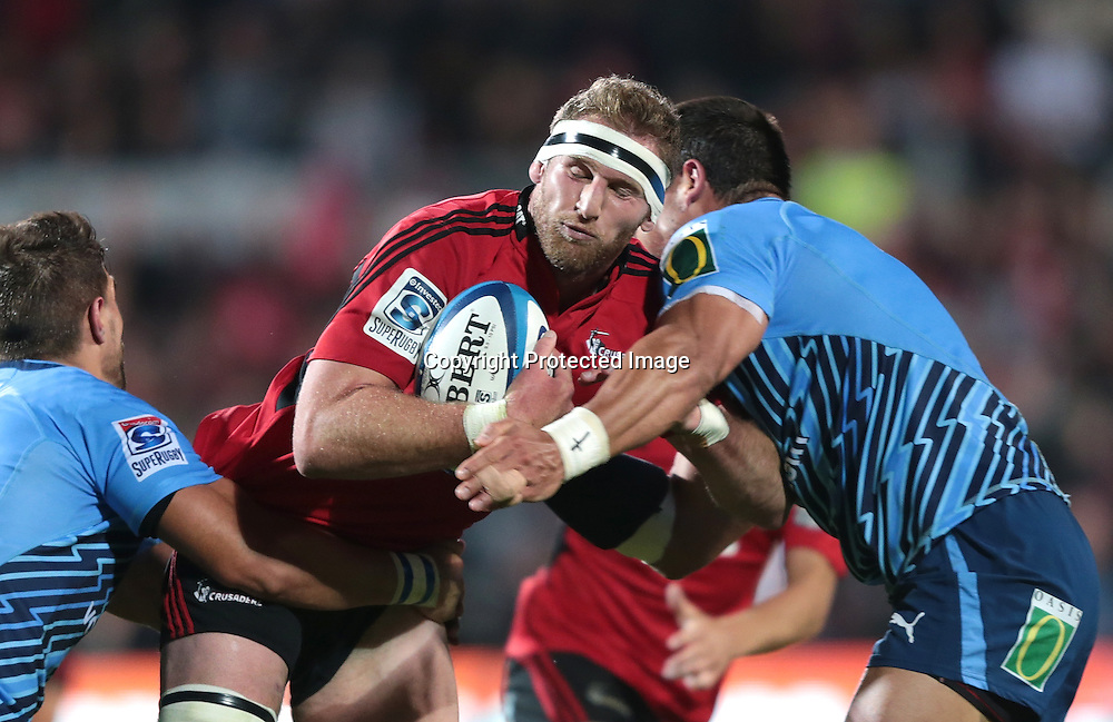 Kieran Read of the Crusaders is tackled during the Super Rugby match between the Crusaders and the Bulls at AMI Stadium on Saturday March 15, 2013 in Christchurch, New Zealand. Photo: Martin Hunter/Photosport