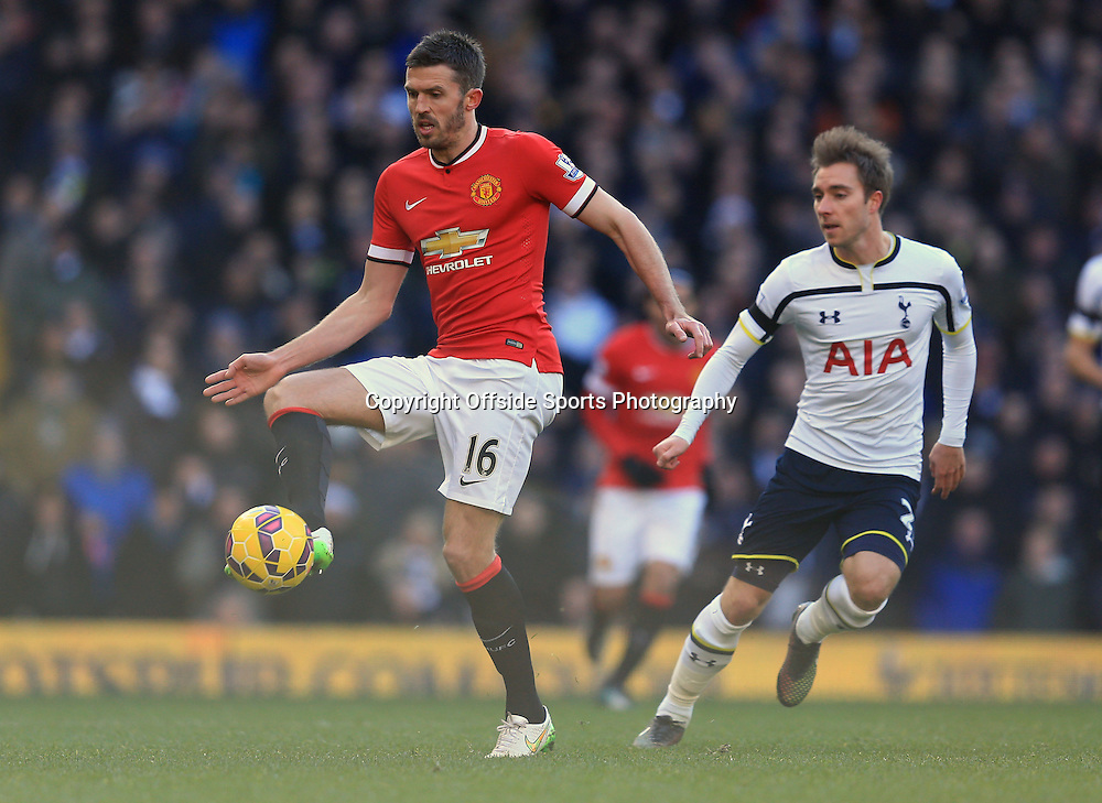 28 December 2014 - Barclays Premier League - Tottenham Hotspur v Manchester United - Michael Carrick of Manchester United in action with Christian Eriksen of Tottenham Hotspur - Photo: Marc Atkins / Offside.