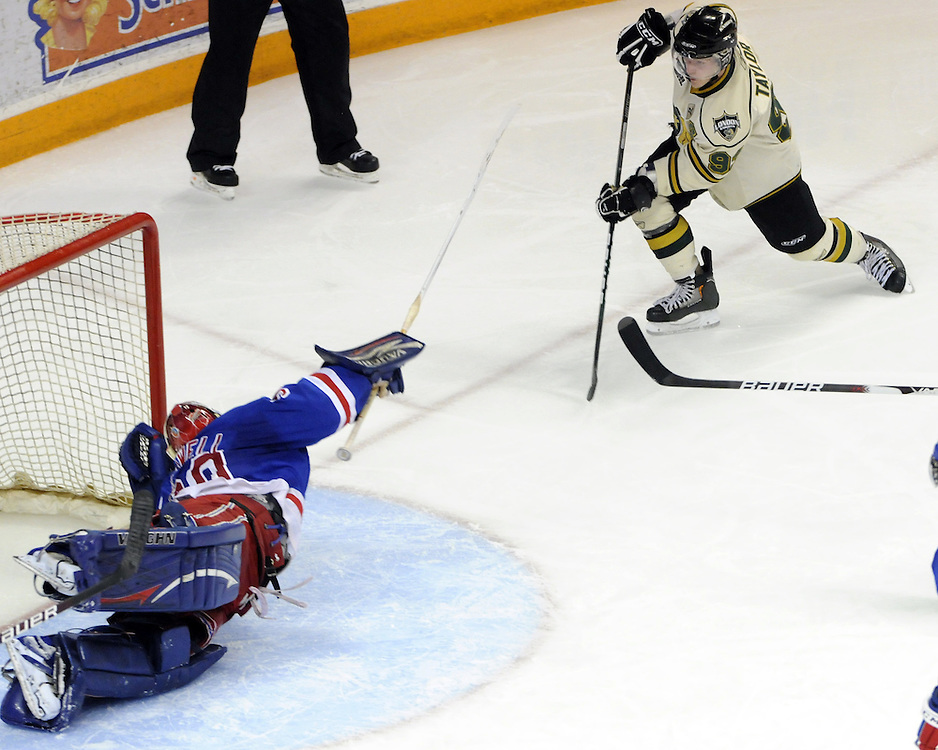 Brandon Maxwell of the Kitchener Rangers makes a save on Justin Taylor of the London Knights in Game 6 of their second round Western Conference matchup on Saturday April 10. Photo by Aaron Bell/OHL Images