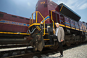 J. Reilly McCarren poses next to an Arkansas & Missouri Railroad engine that was named after him on Thursday, April 17, 2014, in Springdale, Ark. Photo by Beth Hall