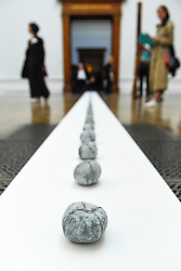 "© Licensed to London News Pictures. 17/09/2019. LONDON, UK. ""One Apple"", 1982, by Antony Gormley. Preview of a new exhibition by Antony Gormley at the Royal Academy of Arts.  The show bring together existing and specially conceived new works from drawing to sculptures to experimental environments to be displayed in all 13 rooms of the RA's Main Galleries 21 September to 3 December 2019.  Photo credit: Stephen Chung/LNP"