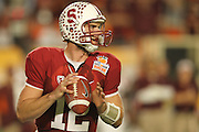 Stanford Cardinal quarterback Andrew Luck (12) drops back to pass against the Virginia Tech Hokies during the 2011 Orange Bowl held at Sun Life Stadium  in Miami Gardens, FL.