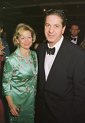 MR & MRS CHARLES SAATCHI, the leading art collectors, at a party in London on 22nd February 1999.MON 173