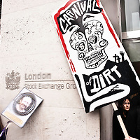 London, UK - 15 June 2012: protesters holding banners in front of the London Stock Exchange during the Carnival of Dirt. More than 30 activist groups from London and around the world have come together to highlight the alleged illicit deeds of mining and extraction companies.