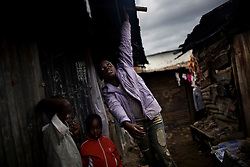 Daily life in Mathare, one of the poorest slums in Nairobi.  Running water and electricity are scarce and trash and human waste fill the streets.  Many people have no jobs and those who do work can earn less than one dollar a day.