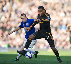 LIVERPOOL, ENGLAND - Saturday, January 29, 2011: Chelsea's Didier Drogba and Everton's John Heitinga during the FA Cup 4th Round match at Goodison Park. (Photo by David Rawcliffe/Propaganda)