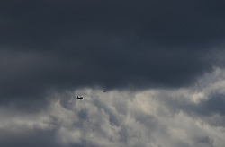 Heathrow Airport, London, March 28th 2016. A boeing 737 follows another aircraft out of London's Heathrow Airport into a forbidding sky as the remnants of Storm Katie blow across southern England.
