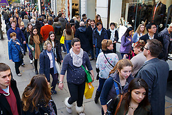 © Licensed to London News Pictures. 30/11/2014. LONDON, UK. People shopping on Oxford Street ahead of Cyber Monday and Christmas on Sunday, 30 November 2014. Photo credit : Tolga Akmen/LNP