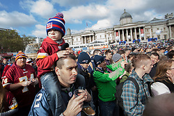 © licensed to London News Pictures. London, UK 27/10/2012. NFL fans are enjoying NFL Fan Rally in Trafalgar Square ahead of this weekend's NFL games at Wembley Stadium between the New England Patriots and the St Louis Rams. Photo credit: Tolga Akmen/LNP