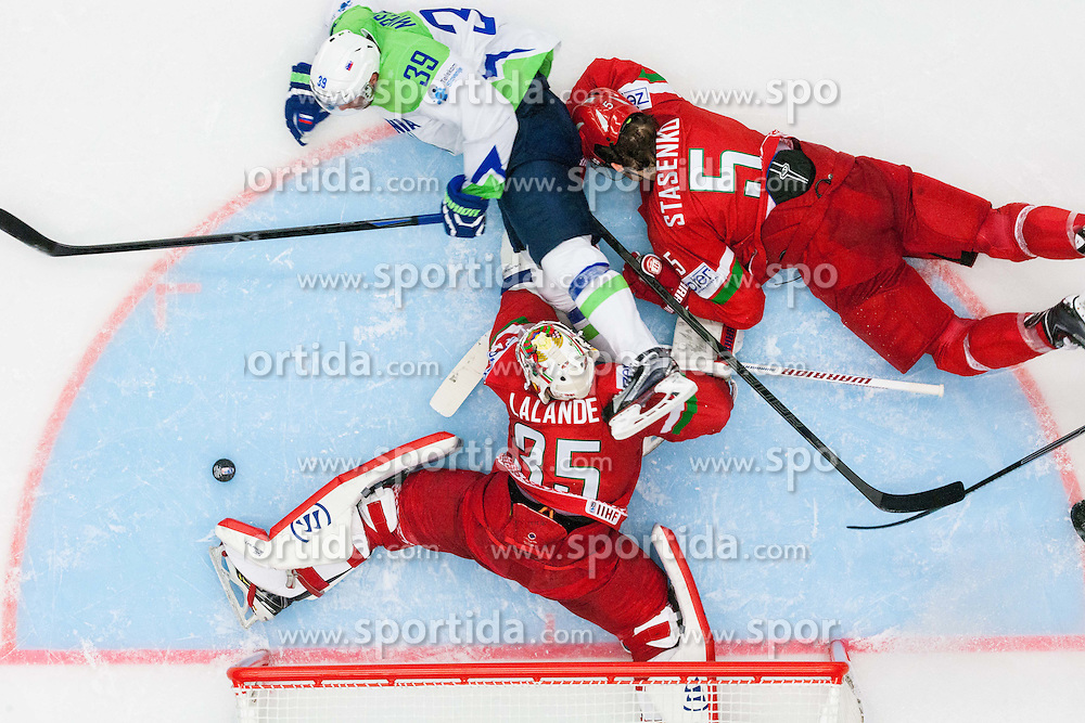 Jan Mursak of Slovenia vs Nikolai Stasenko of Belarus and Kevin Lalande of Belarus during Ice Hockey match between Belarus and Slovenia at Day 2 in Group B of 2015 IIHF World Championship, on May 2, 2015 in CEZ Arena, Ostrava, Czech Republic. Photo by Vid Ponikvar / Sportida