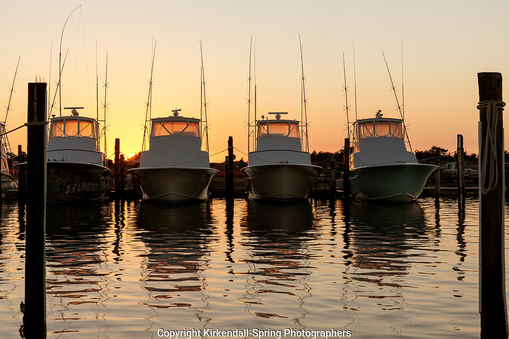 NC00734-00...NORTH CAROLINA - Boats in the Oregon Inlet Marina at sunrise, Bodie Island, Cape Hatteras National Seashore.