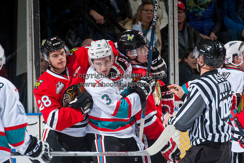 KELOWNA, CANADA - JANUARY 29: Riley Stadel #3 of Kelowna Rockets gets tangled up with Carter Czaikowski #28 and Tanner Nagel #15 of Portland Winterhawks on January 29, 2016 at Prospera Place in Kelowna, British Columbia, Canada.  (Photo by Marissa Baecker/Shoot the Breeze)  *** Local Caption *** Carter Czaikowski; Tanner Nagel; Riley Stadel;