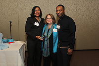 The Hyde Park Chamber of Commerce held its 75th Annual Chamber Dinner this past Thursday. The event was held at Rodfei Zedek located at 5200 S. Harper.<br /> <br /> 8908 – Jacqueline Jackson (left) and Kenneth Faulkner (right) of Kilwins accept the award for new business of the year presented by Joyce Feuer of Joyce's Events and Party Planning (center).