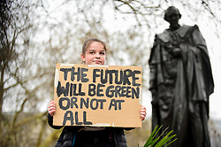 © Licensed to London News Pictures. 15/03/2019. LONDON, UK.  A student holds up a sign in Parliament Square. Thousands of students take part in a Climate Change strike in Parliament Square, marching down Whitehall to Buckingham Palace.  Similar strikes by students are taking part around the world demanding that governments take action against the effects of climate change.  Photo credit: Stephen Chung/LNP