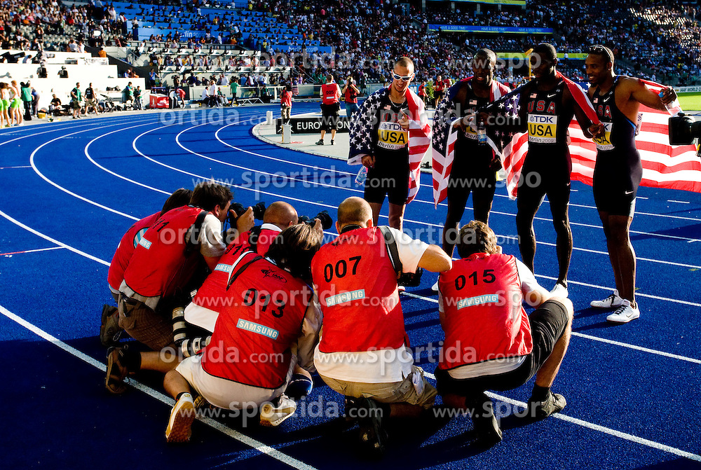 Team of United States celebrates winning the gold medal in the men's 4x400 Metres Relay Final during day nine of the 12th IAAF World Athletics Championships at the Olympic Stadium on August 23, 2009 in Berlin, Germany. (Photo by Vid Ponikvar / Sportida)