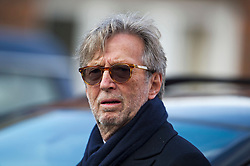 © London News Pictures. 05/11/2014. ERIC CLAPTON arriving for the service. The funeral Jack Bruce at Golders Green Crematorium in North London. Jack Bruce was the lead singer and bass player for British Rock band Creme, alongside Eric Clapton and Ginger Baker. Creme sold over 15 million albums worldwide and were widely considered to be the worlds first successful supergroup. Photo credit : Ben Cawthra/LNP