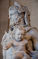 Statue of a man with a child at the Louvre, Paris