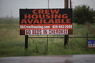 Sign for crew housing in Cherokee, in Alfalfa County, located Northwestern, Oklahoma where the fracking industry is booming.