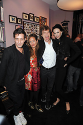Left to right, DAN WILLIAMS, JADE JAGGER, her father MICK JAGGER and L'WREN SCOTT at the opening of Jade Jagger's shop at 43 All Saints Road, London W11 on 25th November 2009.