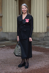 Gallery owner Mrs Victoria Miro displays her OBE for services to art, awarded by The Queen at an investiture ceremony at Buckingham Palace. London, March 15 2018.
