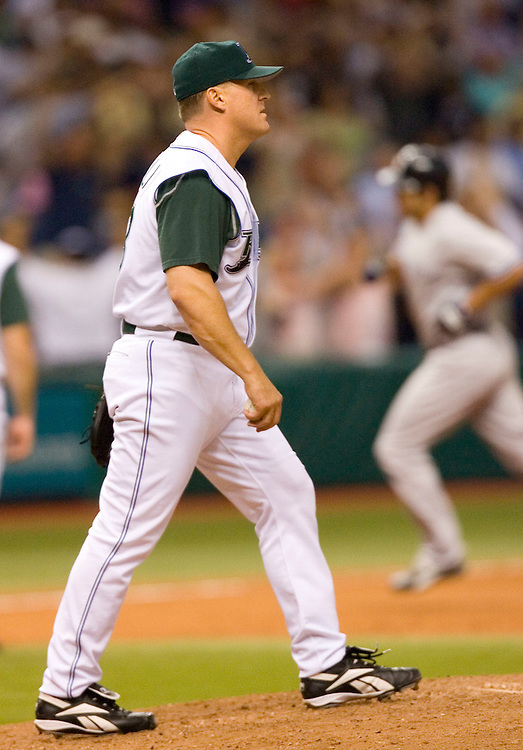 Tampa Bay Devil Rays pitcher Dan Miceli heads back to the mound after giving up a grand slam to the New York Yankees' Johnny Damon, background right, during the eighth inning of their American League baseball game on Thursday, May 4, 2006 in St. Petersburg, Fla.(AP Photo/Scott Audette)