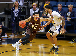Dec 30, 2018; Morgantown, WV, USA; Lehigh Mountain Hawks guard Marques Wilson (20) dribbles while defended by West Virginia Mountaineers forward Esa Ahmad (23) during the second half at WVU Coliseum. Mandatory Credit: Ben Queen-USA TODAY Sports