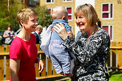© Licensed to London News Pictures. 15/04/2015. LONDON, UK. Yvette Cooper and Harriet Harman meeting George, 3 month old, whilst meeting mothers and children at Stockwell Gardens Nursery in south London to launch Labour's Women's Manifesto on Wednesday, 15 April 2015. Photo credit : Tolga Akmen/LNP