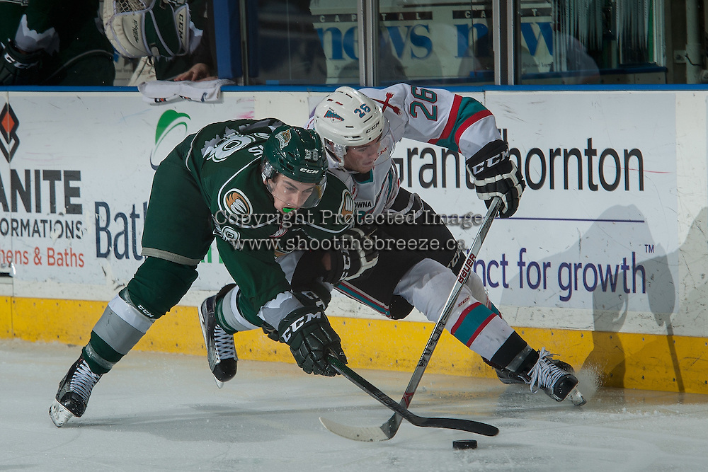 KELOWNA, CANADA - DECEMBER 30: Kevin Davis #38 of Everett Silvertips checks Cole Linaker #26 of Kelowna Rockets on December 30, 2015 at Prospera Place in Kelowna, British Columbia, Canada.  (Photo by Marissa Baecker/Shoot the Breeze)  *** Local Caption *** Cole Linaker; Kevin Davis;