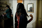 """Sweety and Chabbo (right and left), transvestites respectively of 27 and 32 years old age, are busy one to cook lunch and the other to comb the hairs in front of the mirror of the common room. Chabbo is the Guru for all transvestites of the same block, built on four floors. Lot of transvestites people live in the same area, often in the same building, where they create a kind community in alternative to the society. Afternoon in Lahore, Pakistan on Tuesday, December 02 2008.....""""Not men nor women"""". Just Hijira, Kusra. Painted lips, Kajal surrounding their eyes and colourful veils..Pakistan is today considered a strongly, foundamentalist as well, islamic country. But under its reputation, above all over the talebans' continuos advancing, stirs a completely extraneous world, a multiethnic mixed society. Transvestites make part of it, despite this would not be admitted by a strict law. Third gender, the Hijira are born as men (often ermaphrodites) or with an ambiguous genital situation, and they have their testicles and penis removed through a - often brutal - surgical operation. The peculiarity is that this operation does not contemplate the reconstruction of a female organ. This is the reason why they are not considered as men nor women, just Hijira. They are often discriminated, persecuted  and taxed with being men prostitutes in the muslim areas. The members of this chast perform dances during celebrations, especially during weddings, since it is anciently believed that an EUNUCO's dance and kiss in the wedding day brings good luck to the couple's fertility...To protect the identities of the recorded subjects names and specific .places are fictionals."""